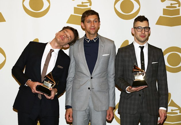 Members of fun., from left, Nate Ruess, Andrew Dost and Jack Antonoff, pose backstage with the song of the year award for &quot;We Are Young&quot; at the 55th annual Grammy Awards on Sunday, Feb. 10, 2013, in Los Angeles. (Photo by Matt Sayles/Invision/AP)