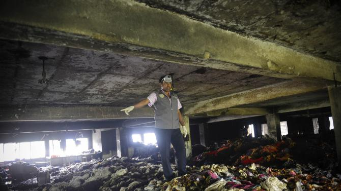 Bangladesh factory collapse death toll hits 1,034