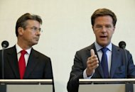 Dutch Prime Minister Mark Rutte (R) and Deputy Prime Minister Maxime Verhagen give a joint press conference in The Hague. The Netherlands is headed for early elections after coalition talks on a fiscal austerity package broke down Saturday, Rutte said