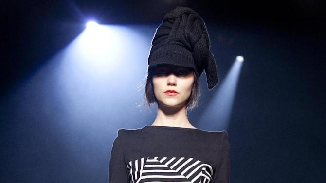 A model walks the runway during the Band of Outsiders Fall 2013 fashion show during Fashion Week, Saturday, Feb. 9, 2013, in New York. (AP Photo/Karly Domb Sadof)