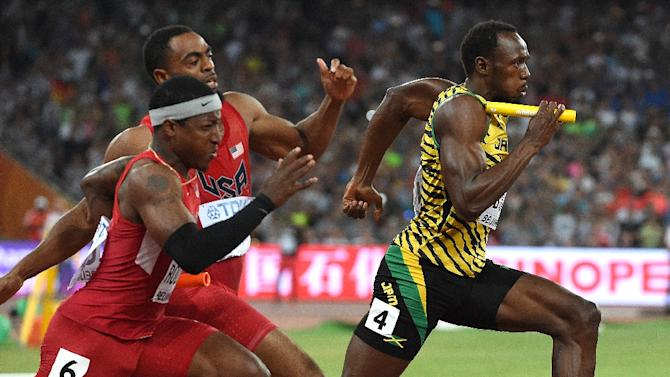 Usain Bolt (R) led a barrage of superstar performances during the world championships at the Bird's Nest stadium in Beijing