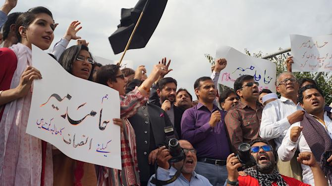 "Pakistani journalists protest for their colleague Hamid Mir, who was shot and injured by gunmen in Karachi on Saturday, Monday, April 21, 2014 in Islamabad, Pakistan. Police in Pakistan said gunmen shot a famous television talk show host amid a wave of attacks on journalists in the country. Police say Hamid Mir, a host on the private television broadcaster Geo, was wounded in the attack Saturday, April 19, 2014, near Karachi's airport. Placard on left reads ""we want justice for Hamid Mir."" (AP Photo/B.K. Bangash)"