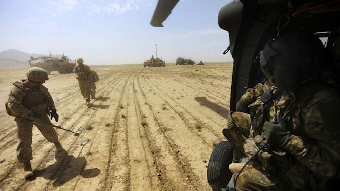 FILE - This Sept. 7, 2011 file photo shows a U.S. Marine sweeping for land mines in the Helmand Province of southern Afghanistan. U.S. troops in Afghanistan have quietly achieved one small but important victory over the past year: They are finding and avoiding more improvised explosive devices, or IEDs, than a year ago. That's thanks to a surge in training, equipment and intelligence.  (AP Photo/Rafiq Maqbool, File)