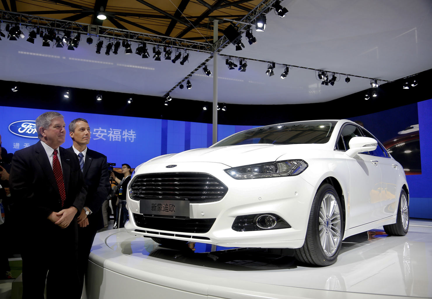 Officials from Ford Motor Co. stand near the new Ford Mondeo model
