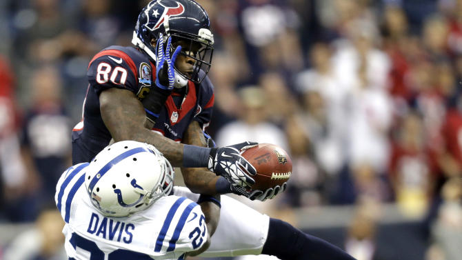 Houston Texans wide receiver Andre Johnson (80) catches a pass for a first down as Indianapolis Colts cornerback Vontae Davis (23) defends during the first quarter of an NFL football game Sunday, Dec. 16, 2012, in Houston. (AP Photo/Eric Gay)