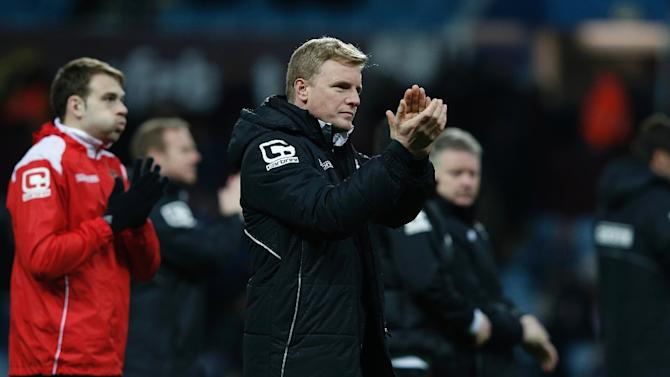 Bournemouth's manager Eddie Howe applauds after the final whistle in the FA Cup fourth round football match between Aston Villa and Bournemouth on January 25, 2015