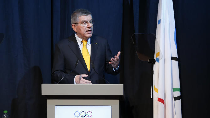 President of the International Olympic Committee (IOC) Thomas Bach, speaks during the opening ceremony of IOC in Kuala Lumpur, Malaysia,Thursday, July 30, 2015. Malaysia is hosting the 128th International Olympic Committee executive board meeting where the vote for the host cities of the 2022 Olympic Winter Games and for the 2020 Youth Olympic Winter Games will take place. (AP Photo/Vincent Thian)