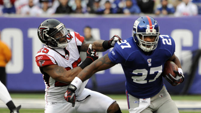 Atlanta Falcons strong safety William Moore (25) tries to stop New York Giants running back Brandon Jacobs (27) during the first half of an NFL wild card playoff football game Sunday, Jan. 8, 2012, in East Rutherford, N.J. (AP Photo/Bill Kostroun)