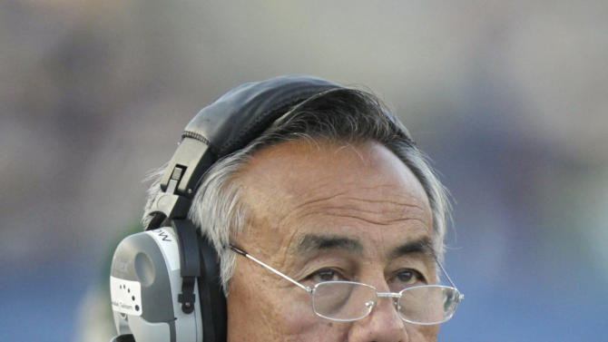 Hawaii coach Norm Chow looks up during the first quarter of an NCAA college football game against Brigham Young on Friday, Sept. 28, 2012, in Provo, Utah.  (AP Photo/Rick Bowmer)