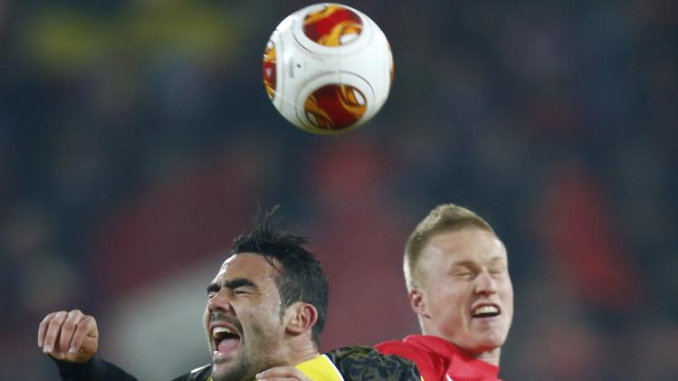 Freiburg's Lorenzoni and Sevilla's Iborra fight for the ball during their Europa League soccer match in Freiburg