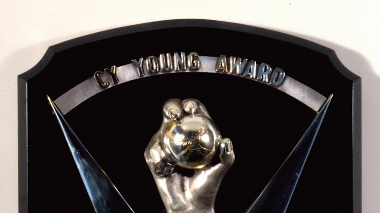 This photo released by Hunt Auctions shows one of three Cy Young Awards and two Gold Gloves awarded to former Baltimore Orioles pitcher Jim Palmer. Palmer no longer has any need for his Cy Young awards, and he also is auctioning off his  Gold Gloves. He's rather have the money than the hardware, for all the right reasons.  (AP Photo/Courtesy of Hunt Auctions)