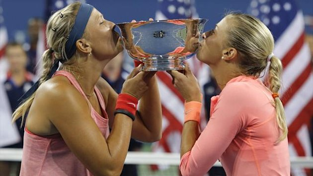 Andrea Hlavackova and Lucie Hradecka (L) of the Czech Republic kiss their trophy defeating Ashleigh Barty and Casey Dellacqua of Australia in their women's doubles final match at the U.S. Open tennis championships (Reuters)