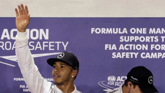 Mercedes Formula One driver Lewis Hamilton of Britain waves to fans after winning the pole position during the qualifying session of Singapore F1 Grand Prix