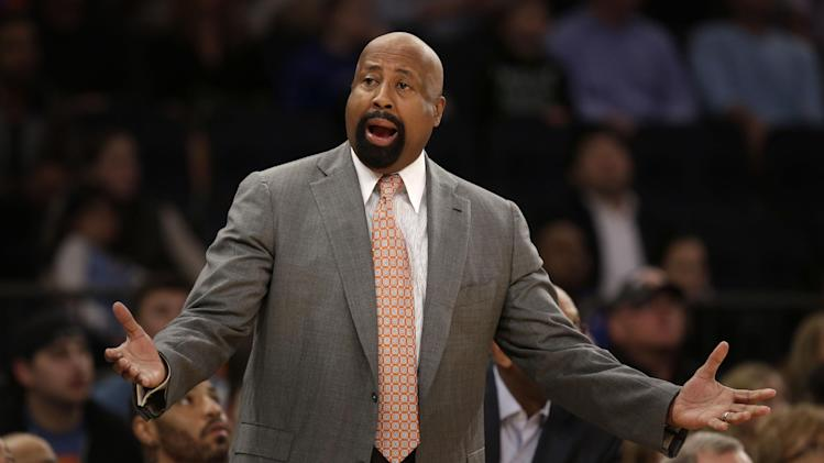 New York Knicks' Mike Woodson reacts  during the first half of the NBA basketball game against the Chicago Bulls, Sunday, April 13, 2014 in New York