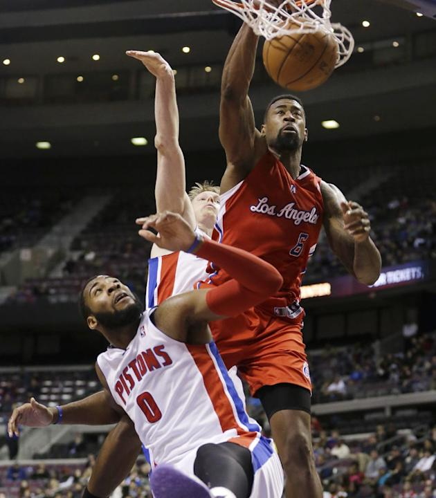 Los Angeles Clippers center DeAndre Jordan (6) dunks over Detroit Pistons center Andre Drummond (0) and forward Kyle Singler during the second half of an NBA basketball game in Auburn Hills, Mich., Mo