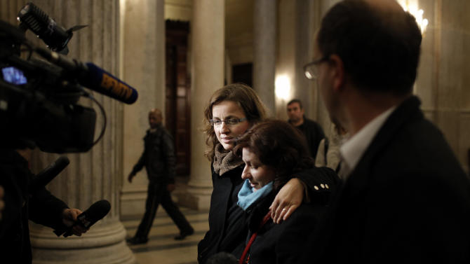 Stephanie Carrouget, left, and Karine Pomares, right, leave the Lyon's courthouse, central France, at the end of the trial of Regis de Camaret, Friday, Nov. 23, 2012. The former tennis coach Regis de Camaret has been convicted and sentenced to eight years in prison for raping Stephanie Carrouget and Karine Pomares attending the academy he used to run in Saint-Tropez. The case began with a book by Isabelle Demongeot, who described years of abuse. Several other women later came forward with accusations that the now-70-year-old Camaret raped or abused them when they trained in the 1980s and 1990s. The statute of limitations has run out for all but two of the accusers. (AP Photo/Laurent Cipriani)