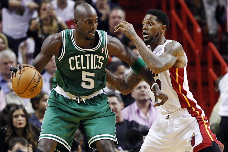 Boston Celtics' Kevin Garnett (5) backs down Miami Heat's Udonis Haslem (40) during the first half of their NBA basketball game, Tuesday, Oct. 30, 2012, in Miami. (AP Photo/J Pat Carter)