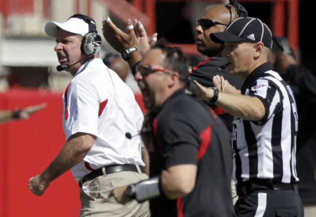 Nebraska head coach Bo Pelini, left, reacts to a play in the first half of an NCAA college football game against Arkansas State in Lincoln, Neb., Saturday, Sept. 15, 2012. Pelini left Saturday's game against Arkansas State by ambulance after falling ill on the sideline in the first half. (AP Photo/Nati Harnik)