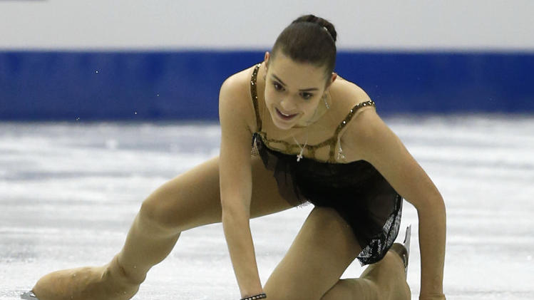 Adelina Sotnikova of Russia falls as she performs during the women's free programme at the ISU Grand Prix of Figure Skating Final in Fukuoka