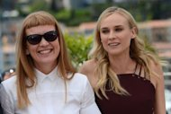 "British director and scriptwriter Andrea Arnold (L) and German actress Diane Kruger pose during the photocall of the jury of the 65th Cannes film festival. Arnold said Wednesday she would ""hate"" to be selected on gender grounds, as disappointment over the all-male line-up clouded the filmfest's opening day"