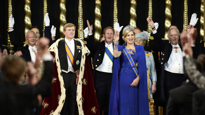 Dutch King Willem-Alexander is given three cheers by guests and his wife Queen Maxima inside the Nieuwe Kerk or New Church in Amsterdam, The Netherlands, during his inauguration Tuesday April 30, 2013. Around a million people are expected to descend on the Dutch capital for a huge street party to celebrate the first new Dutch monarch in 33 years. (AP Photo/Lex van Lieshout, Pool)