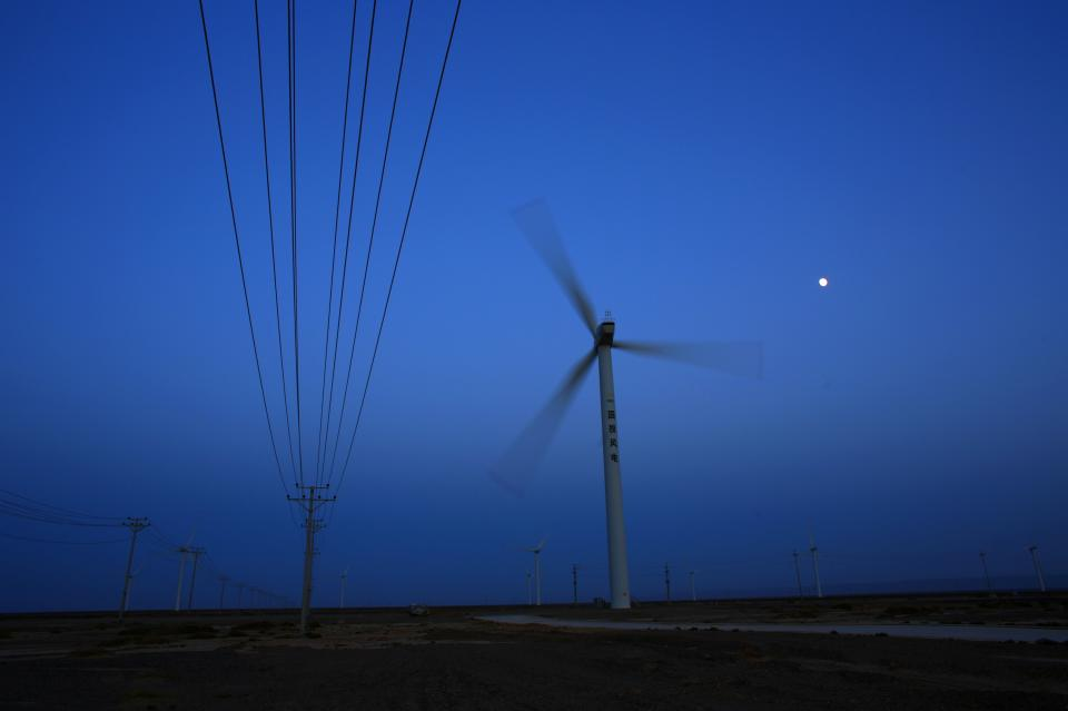 A wind turbine for generating electricity is seen at a wind farm in Guazhou, 950km northwest of Lanzhou, Gansu Province