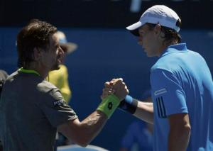 Ferrer of Spain clasps hands with Gonzalez of Colombia after winning their men's singles match at the Australian Open 2014 tennis tournament in Melbourne