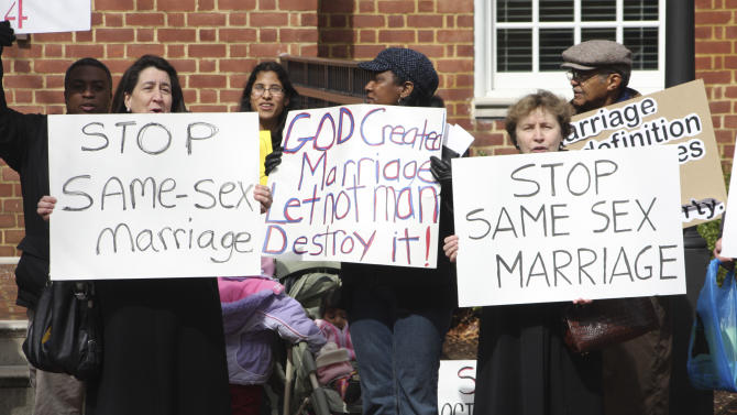 Opponents of gay marriage rally in Annapolis, Md., Friday, March 11, 2011 before the Maryland House of Delegates holds a vote on legislation that would give same-sex couples in Maryland the same marriage rights as heterosexuals. (AP Photo/Brian Witte)