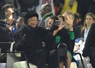 Nelson Mandela (left) and his wife Graca Machel at Soccer City in Soweto on July 11, 2010 for the World Cup final. Mandela has not been seen in public since that event