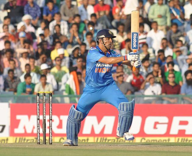 M S Dhoni in action during the 3rd ODI between India and Australia at  Punjab Cricket Association Stadium, Mohali, Chandigarh on Oct. 19, 2013. (Photo: IANS)