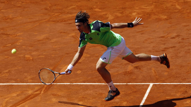 David Ferrer from Spain returns the ball to Rafael Nadal from Spain during the Madrid Open tennis tournament, in Madrid, Friday, May 10, 2013. (AP Photo/Daniel Ochoa de Olza)