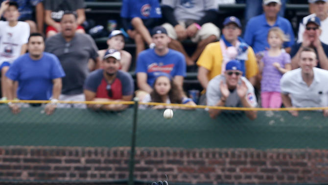 Los Angeles Dodgers right fielder Matt Kemp catches a fly ball hit by Chicago Cubs' Arismendy Alcantara for an out during the first inning of a baseball game on Saturday, Sept. 20, 2014, in Chicago. (AP Photo/Andrew A. Nelles)