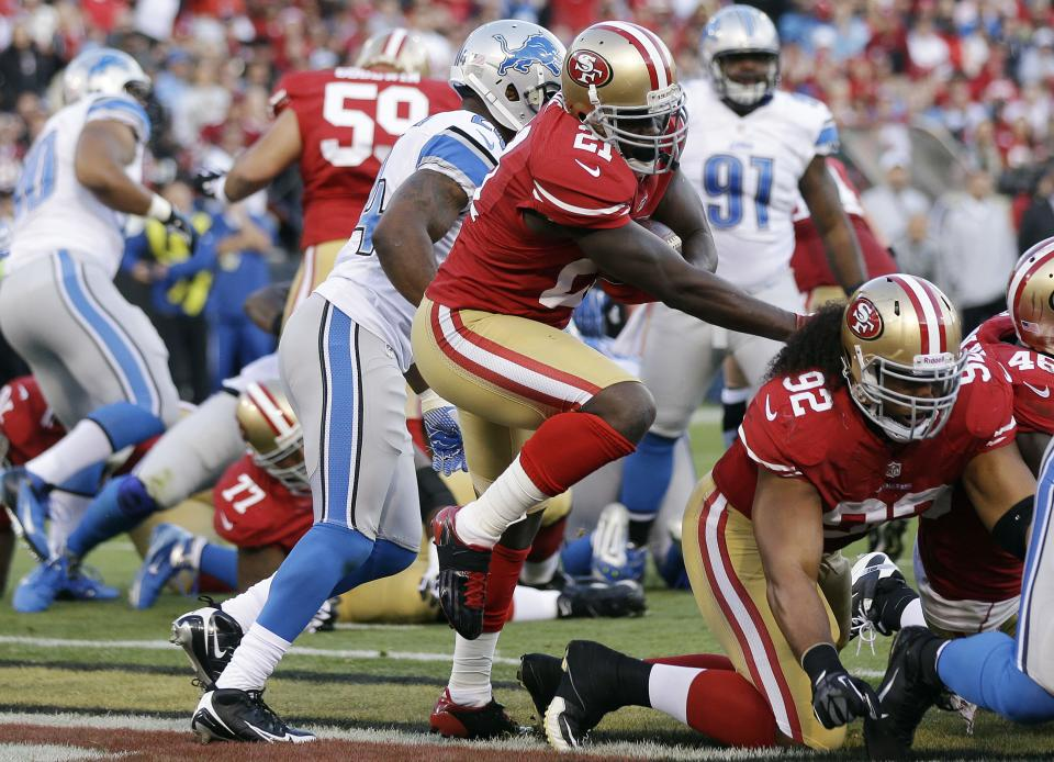 San Francisco 49ers running back Frank Gore carries the ball into the end zone for a touchdown during the second quarter of an NFL football game against the Detroit Lions in San Francisco, Sunday, Sept. 16, 2012. At right is 49ers defensive tackle Will Tukuafu (92). (AP Photo/Marcio Jose Sanchez)