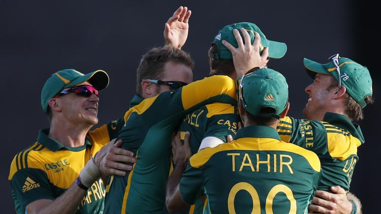 South Africa's captain de Villiers celebrates with teammates Morkel, Steyn and Tahir during their final One Day International cricket match in Hambantota