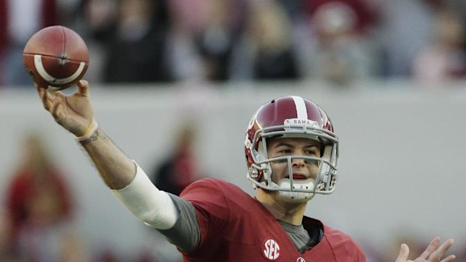 Alabama quarterback AJ McCarron (10) looks for a receiver during the first half of a NCAA college football game against Auburn at Bryant-Denny Stadium in Tuscaloosa, Ala., Saturday, Nov. 24, 2012. (AP Photo/Dave Martin)