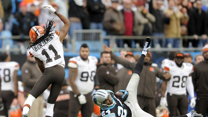 Carolina Panthers' Josh Norman (24) intercepts a pass intended for Cleveland Browns' Travis Benjamin (11) in the second half of an NFL football game in Charlotte, N.C., Sunday, Dec. 21, 2014. (AP Photo/Mike McCarn)