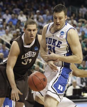 Lehigh's Justin Maneri (31) knocks the ball from Duke's Miles Plumlee (21) during the first half of an NCAA tournament second-round college basketball game in Greensboro, N.C., Friday, March 16, 2012. (AP Photo/Chuck Burton)