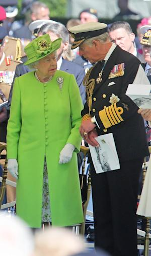 Britain's Queen Elizabeth II, left speaks with …