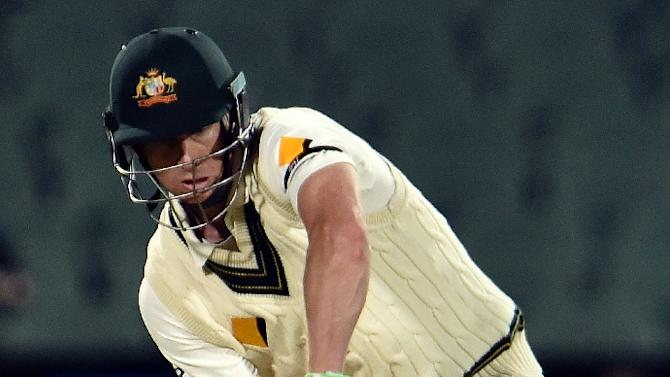 Australia's batsman Adam Voges plays a shot against New Zealand during the first day-night cricket Test match at the Adelaide Oval on November 27, 2015