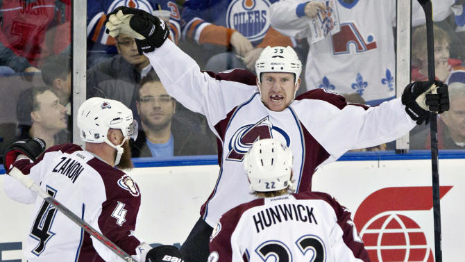 Colorado Avalanche's Greg Zanon, Cody McLeod and Matt Hunwick celebrate McLeod's goal against the Edmonton Oilers during the first period of an NHL hockey game in Edmonton, Alberta, on Saturday Feb. 16, 2013. (AP Photo/The Canadian Press, Jason Franson)