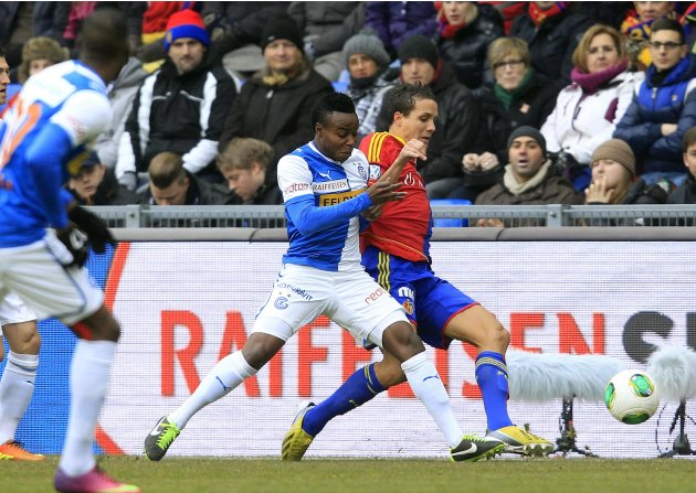 FC Basel's Stocker challenges Toko of Grasshopper Club during their Swiss Super League soccer match in Basel