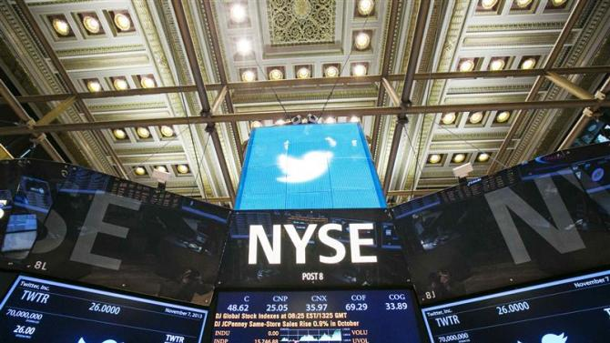 The Twitter Inc. logo is displayed on screens prior to its IPO on the floor of the New York Stock Exchange in New York