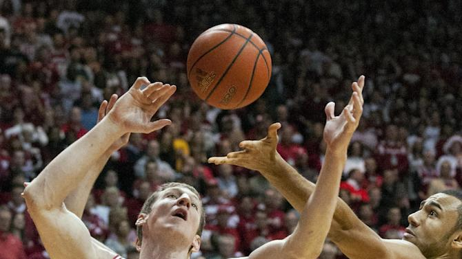 Indiana's Cody Zeller (40) goes after a rebound with Michigan's Jon Horford (15) during the first half of an NCAA college basketball game Saturday, Feb. 2, 2013, in Bloomington, Ind. (AP Photo/Doug McSchooler)