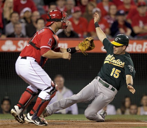 A's capitalize on errors, hold off slumping Angels