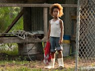 FILE - This publicity photo released by Fox Searchlight Pictures shows Quvenzhane Wallis portraying Hushpuppy in a scene from the film,&quot;Beasts of the Southern Wild.&quot; By all accounts, the young star, Wallis, is an actress of talent, poise and maturity well beyond her years. She was 6 when she played the part of Hushpuppy, and at only 9, she is the youngest-ever best actress nominee at the Academy Awards. (AP Photo/Fox Searchlight Pictures, Mary Cybulski, File)