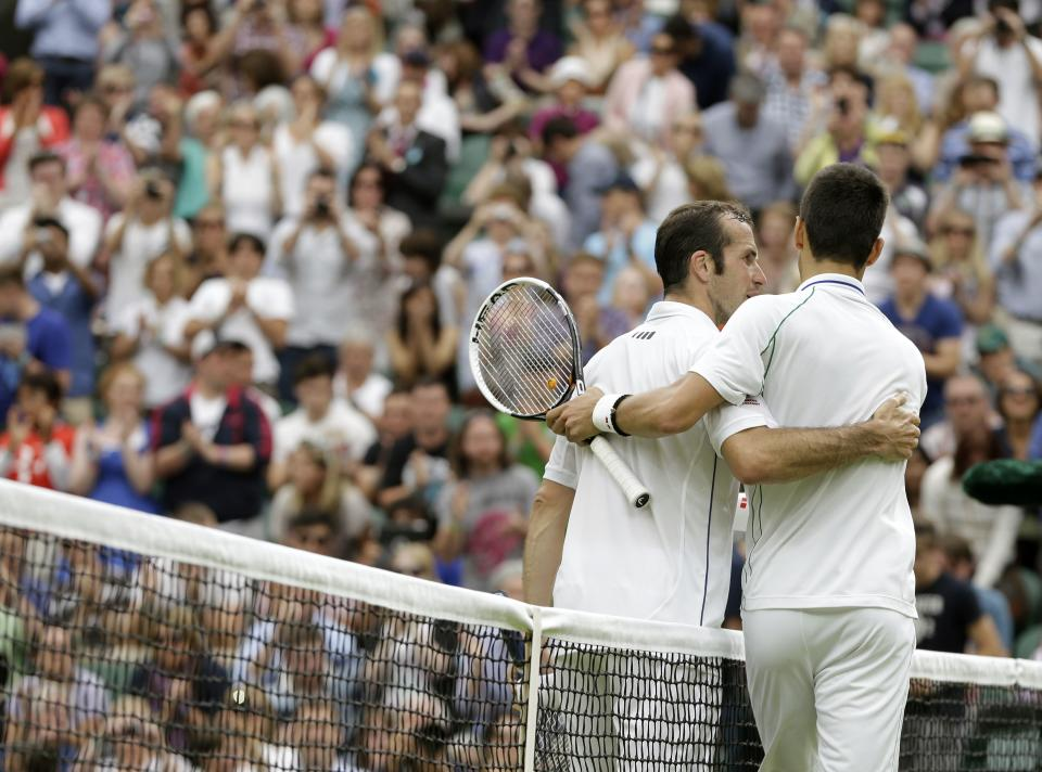 Novak Djokovic of Serbia, right, is congratulated by Radek Stepanek of the Czech Republic in a third round men's singles match at the All England Lawn Tennis Championships at Wimbledon, England, Friday, June  29, 2012. (AP Photo/Alastair Grant)