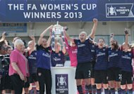 Shelley Kerr and Steph Houghton of Arsenal lift the womens FA Cup