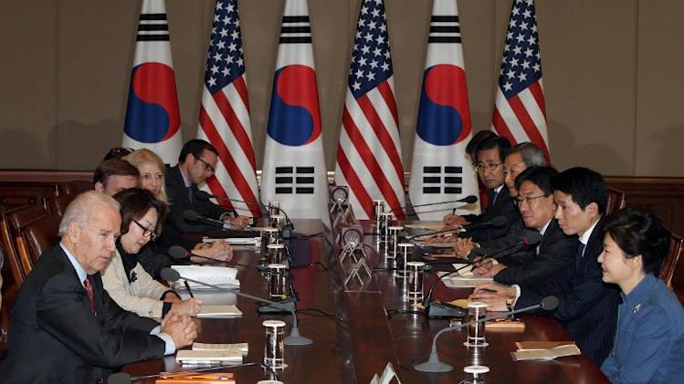 South Korean President Park Geun-Hye (R) speaks with US Vice President Joe Biden during their meeting at the presidential Blue House in Seoul on December 6, 2013
