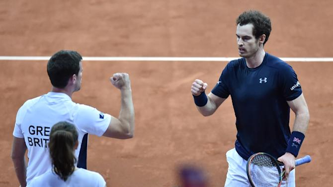 Andy Murray (R) celebrates with Britain's captain Leon Smith after winning his tennis match against Belgium's Ruben Bemelmans on the first day of the Davis Cup final in Ghent on November 27, 2015