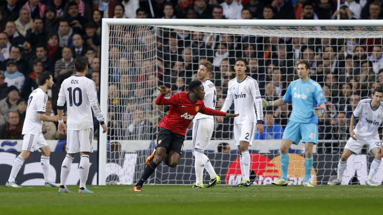 Manchester United's Danny Welbeck, center, celebrates after scoring the opening goal during the Champions League round of 16 first leg soccer match against Real Madrid at the Santiago Bernabeu stadium in Madrid, Wednesday, Feb. 13, 2013.  (AP Photo/Daniel Ochoa de Olza)